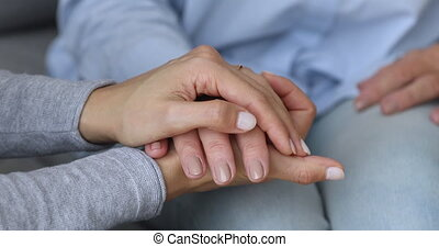Young woman daughter caregiver holding hand helping old ...