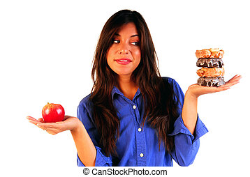 Attractive young woman deciding to eat a healthy apple or unhealthy donut