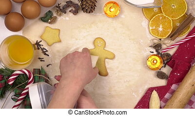 Young woman decorates colored glaze festive Christmas cookies in the form of human. View from above time-lapse. 4k