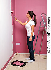 Young woman decorating