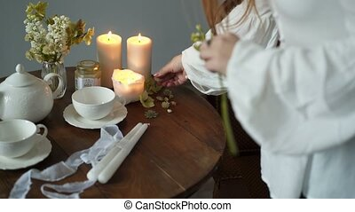Young woman decorating table with flowers