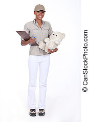 Young woman delivering a teddy bear