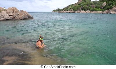 Young Woman Dives in Lake Malawi Snorkeling