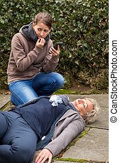 young woman do an emergency call, cause a senior adult is...