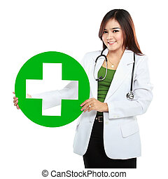 Young woman doctor holding medical sign
