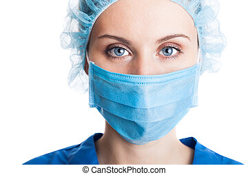 Young woman doctor in cap and face mask