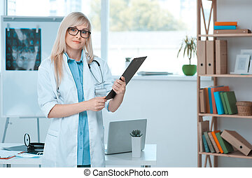 Young woman doctor occupation in the hospital office
