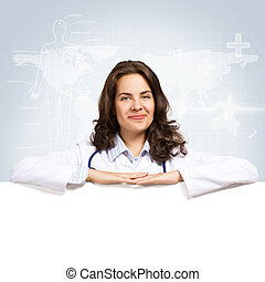 young woman doctor with a blank banner - Young attractive ...