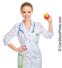 Young woman doctor with stethoscope and apple