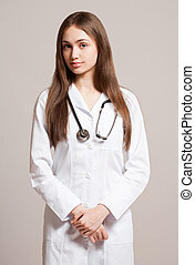 Young woman doctor with stethoscope.