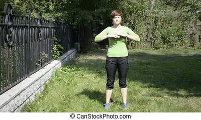 Young woman does warm up