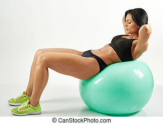 Young woman doing abs crunches