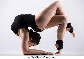 Young woman doing acrobatic exercise - Beautiful flexible...