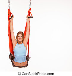 Young woman doing anti-gravity aerial yoga in hammock -...