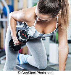 Young woman doing back exercise