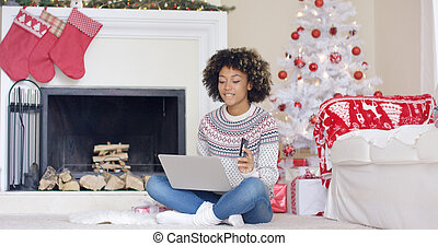 Young woman doing Christmas shopping online