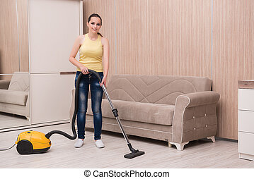 Young woman doing cleaning at home