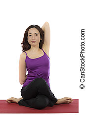 Young woman doing Cow Face Pose in Yoga
