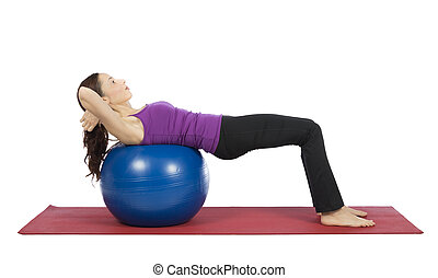 Young woman doing crunch on pilates ball