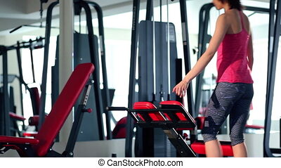 Young woman doing exercise for back at the gym - Young woman...