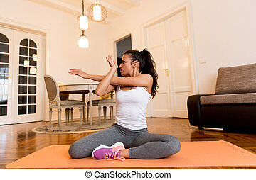 Young woman doing exercise in the room