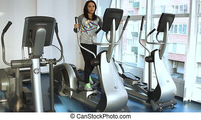 young woman doing exercise on a ell