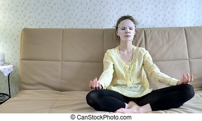 Young woman doing facial mask mask with cleansing mask on...