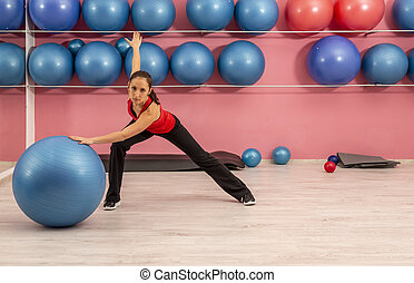 Young Woman Doing Fitness in a Gym