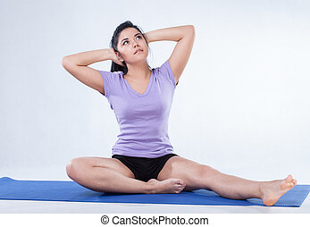 Young woman doing fitness