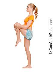 Young woman doing gymnastic exercises