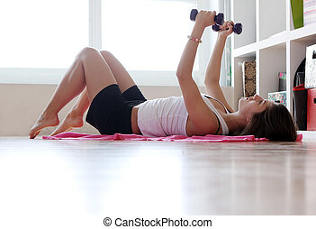 Young woman doing gymnastic exercises