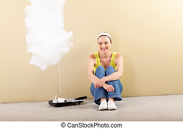 young woman doing home improvement