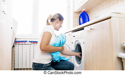 Young woman doing housework in laundry