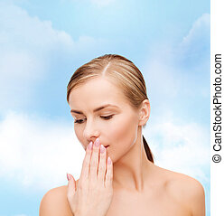 young woman doing hush gesrute - health and beauty concept...