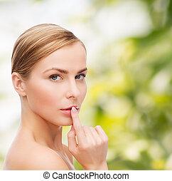 young woman doing hush gesrute