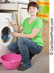 woman doing laundry at her home