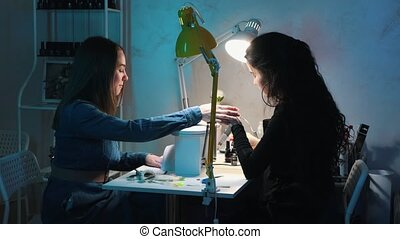 Young woman doing manicure in the beauty salon. Mid shot