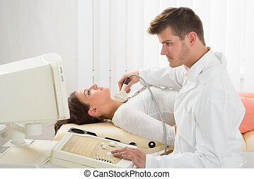 Young Woman Doing Neck Ultrasound Examination