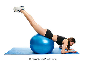 Young woman doing roll-out on the fitness ball