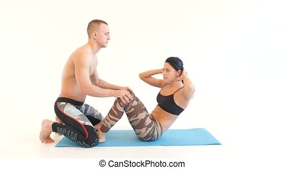Young Woman Doing Sit-Ups with Turns