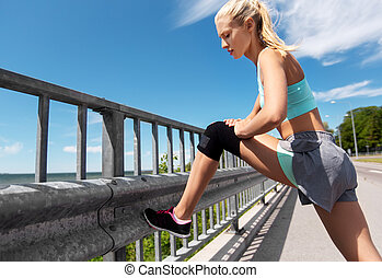 young woman doing sports outdoors