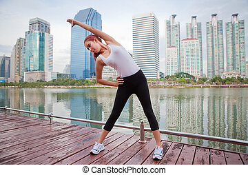 Young woman doing stretching exercise - Beautiful young...