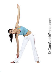 young woman doing the triangle pose in yoga