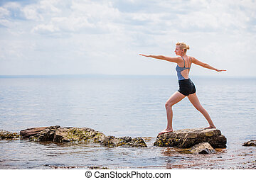 Young Woman doing Warrior Yoga Position