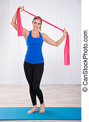 Woman Doing Workout By Standing On Exercise Mat