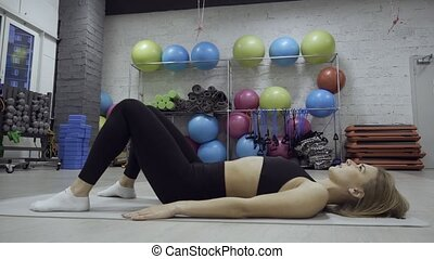 Young woman doing workout exercise - Young blonde woman ...