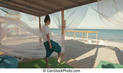 Young woman doing workout near the sea