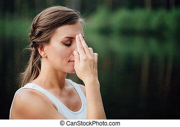 Young Woman Doing Yoga Meditation Exercises, symbolic hand...