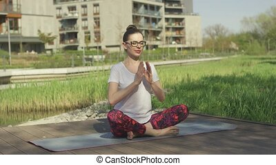Young woman doing yoga near home - Beautiful female in...