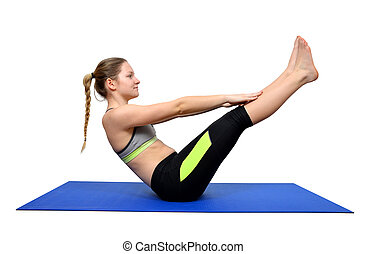 Young woman doing yoga on the mat